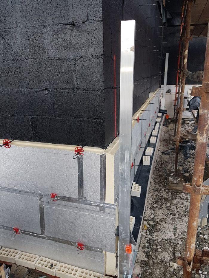 anchored insulation on blowerproof